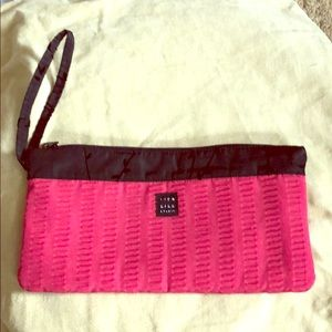 1154 Lill studio clutch.  Raspberry and black